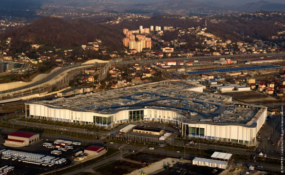 An aerial view from a helicopter shows the Main Media Center building in the Adler district of the Black Sea resort city of Sochi