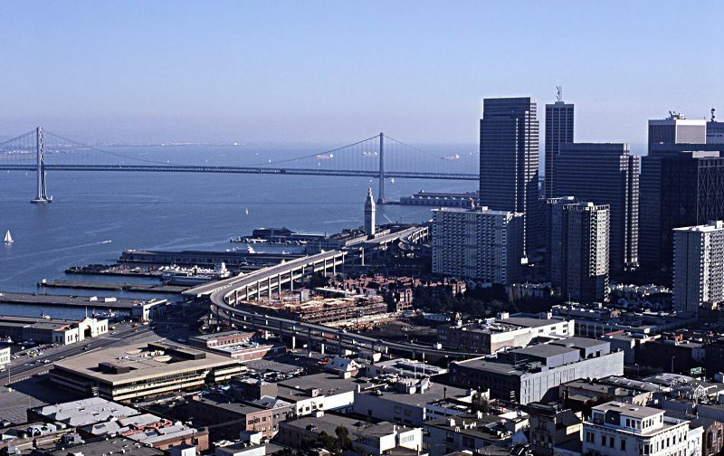 San Francisco Skyline in February 1982. Embarcadero Skyway and Ferry Building at center. Bay Bridge at rear. The northeastern portion of downtown is at right.